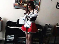 Gorgeous crossdresser Kirsty is wearing a pretty maids outfit and is enjoying a group orgy