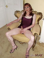 Classy looking Lucimay spreads her legs to show cock