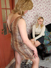 Blondie fitting on strap-on before drilling sissy guy